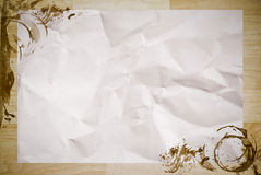 Crumpled paper with coffee stained on wood royalty free stock photos