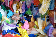 Crumpled paper cranes stock photos