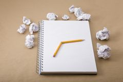 Crumpled paper and crushed yellow pencil Royalty Free Stock Image