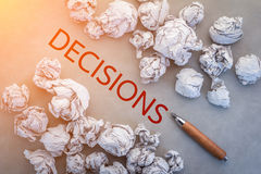 Crumpled paper and decision text and pencil Royalty Free Stock Image