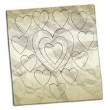 Crumpled paper with drawings of hearts Stock Image