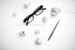 Crumpled paper and eyeglasses with pen black and white tone colo Stock Photography