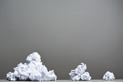 Crumpled paper on a gray background. Royalty Free Stock Photo