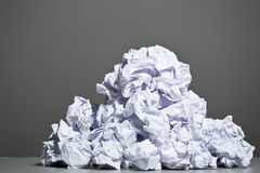 Crumpled paper on a gray background. Stock Images