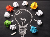 Crumpled paper with a hand drawn lightbulb Stock Photography