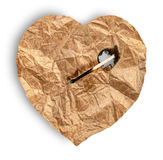 Crumpled paper heart burns match Royalty Free Stock Photo