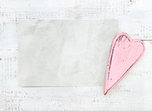 Crumpled paper heart on a white background Royalty Free Stock Photos
