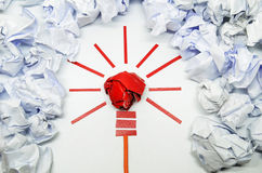 Crumpled paper light bulb metaphor for good idea Stock Images