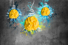 Crumpled paper light bulbs. Crumpled yellow paper light bulbs stock images