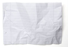 Crumpled paper with lines and holes  on white Stock Photography