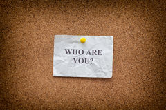 Crumpled paper note with the question Who are you? Stock Image