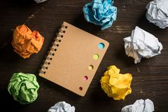 Crumpled paper and a notebook stock image