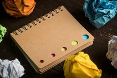 Crumpled paper and a notebook royalty free stock images