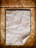 Crumpled paper on old wall. Blank White Crumpled peper on old orange wall Stock Photo