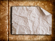 Crumpled paper on old wall. Crumpled paper on brown old wall Stock Image