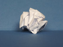 Crumpled paper over blue background with copy space Stock Image