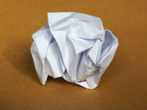Crumpled paper over brown background with copy space Stock Image