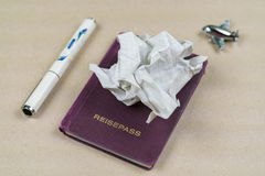 Crumpled paper on a passport with pen Royalty Free Stock Images