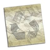 Crumpled paper with recycling symbol Royalty Free Stock Image