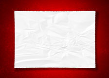 Crumpled paper on red stock photo