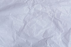 Crumpled paper sheet. Closeup. Texture of wrinked paper surface Royalty Free Stock Images
