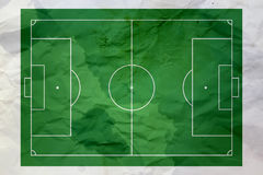 Crumpled paper and soccer background Stock Photo