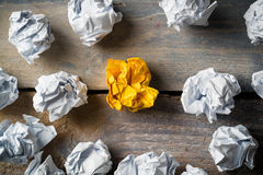 Crumpled paper symbolizing different solutions with one standing out. With a different color Stock Image