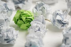 Crumpled paper symbolizing different solutions with one standing out with a different color Stock Photos