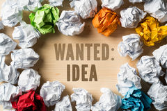 Crumpled paper symbolizing different solutions and phrase `Wanted: IDEA` Stock Images