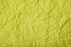 Crumpled paper texture. Close-up fragment of a green crumpled paper texture as a backdrop composition stock photo