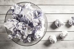 Crumpled paper in the trash can Royalty Free Stock Image