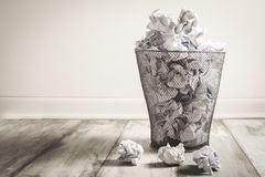 Crumpled paper in the trash can Royalty Free Stock Photography