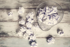 Crumpled paper in the trash can Royalty Free Stock Images