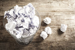 Crumpled paper in the trash can Royalty Free Stock Photo