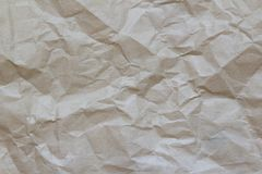 Crumpled Paper Wallpaper. wrinkle recycle paper background. For designers stock photography