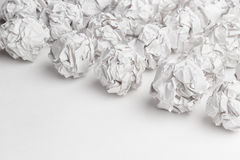 Crumpled paper on white table brainstorming Stock Images