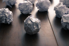 Crumpled paper on wood background. Business frustrations, Job st Stock Image