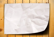 Crumpled paper on wood table Stock Photo