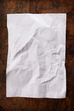 Crumpled paper on wood table Stock Photos