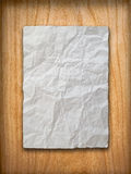 Crumpled paper on wood wall. Blank White Crumpled peper on wood wall Royalty Free Stock Images