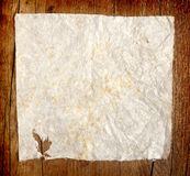 Crumpled paper on wooden background Royalty Free Stock Image