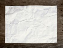 Crumpled paper on wooden background Royalty Free Stock Images