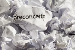 Paper written preconceito, portuguese word for prejudice. Concep. Crumpled paper written preconceito, portuguese word for prejudice. Illustrative concept of Royalty Free Stock Photo