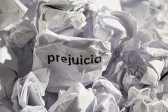 Paper written prejuicio, spanish word for prejudice. Concept of. Crumpled paper written prejuicio, spanish word for prejudice. Illustrative concept of ideology Stock Photos