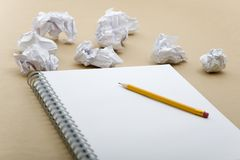 Crumpled paper and yellow pencil Royalty Free Stock Images