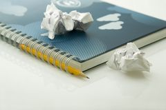 Crumpled papers and notebook Royalty Free Stock Photo