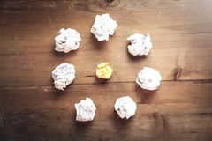 Crumpled papers on wooden background. Idea royalty free stock photo