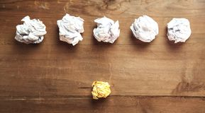 Crumpled papers on wooden background. Idea stock photos