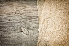 Crumpled parchment on wood Royalty Free Stock Photos