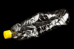 Crumpled pastic oil bottle  on the black background Stock Photo